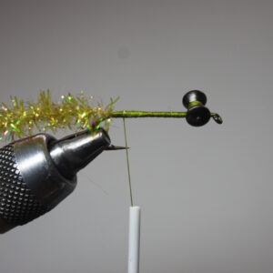 Step 2: Secure chenille at rear of hook.