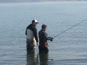 Mike with a guest at Pyramid Lake